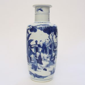 A blue and white boys vase