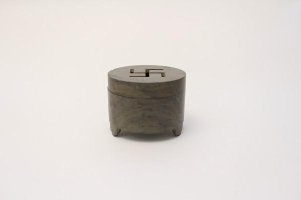 A cylindrical stone tripod censer