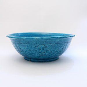 A large turquoise-glazed bowl