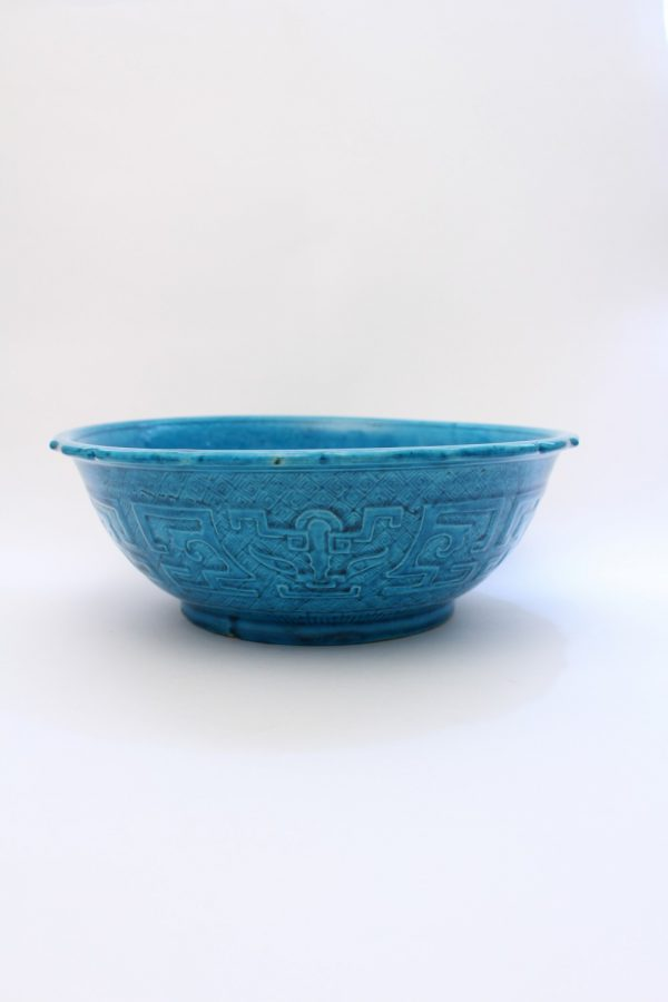 A large turquoise-glazed bowl