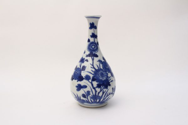 A small blue and white bottle vase