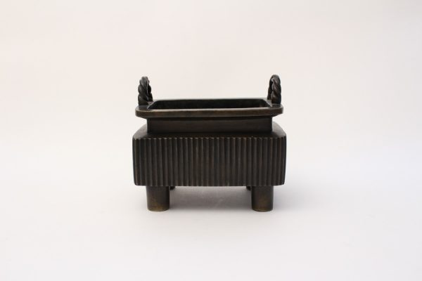 A rectangular ribbed bronze censer