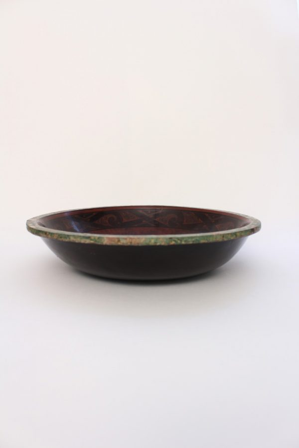 A painted brown lacquer circular basin