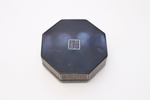 An octagonal mother-of-pearl inlaid box and cover