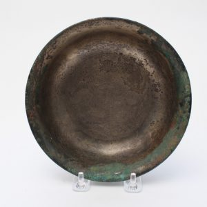 A bronze bowl with incised decoration, the outside in black lacquer
