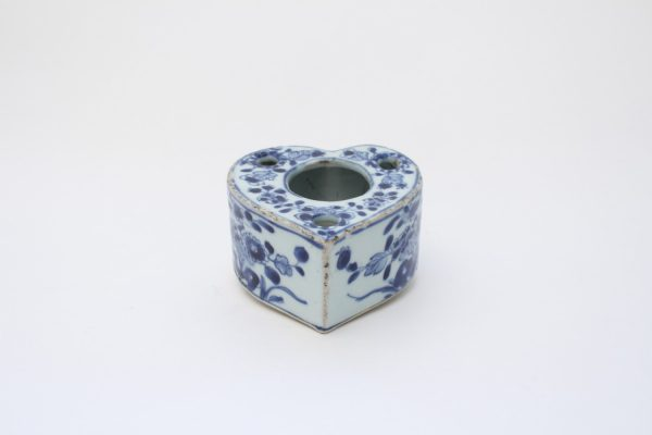 A blue and white heart-shaped washer