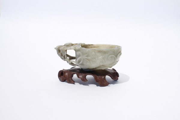 A mottled jade archaistic wine cup