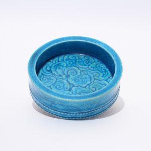 A turquoise-glazed brush washer