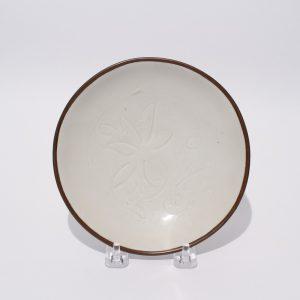A superbly carved 'Ding' floral bowl