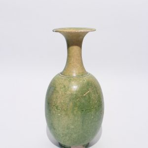 A green-glazed long-necked vase