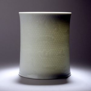 A 'Qingbai' glazed 'bats' brush pot with incised beehive pattern (Yongzheng mark and probably of the period)