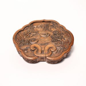 A bamboo lobed box with figural landscape design (Qing dynasty, 19th century)