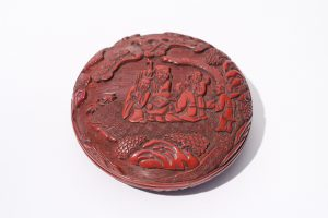 A carved cinnabar lacquer circular box and cover (Mid-Ming period, 16th century)
