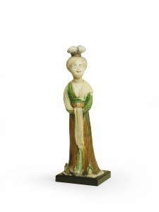 A 'sancai' ware figure of a female attendant (Tang Dynasty)