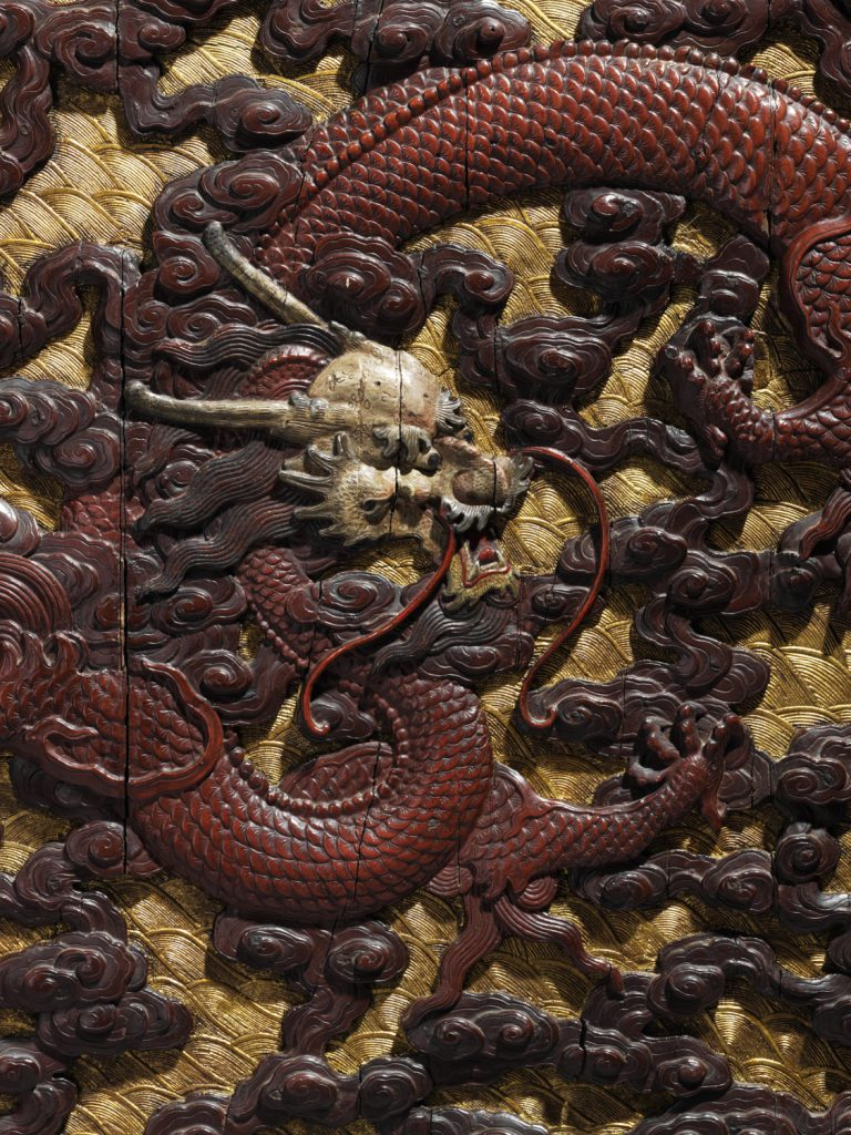 A pair of imperial carved wood, polychrome and gilt-lacquered 'dragon' panels (detail)