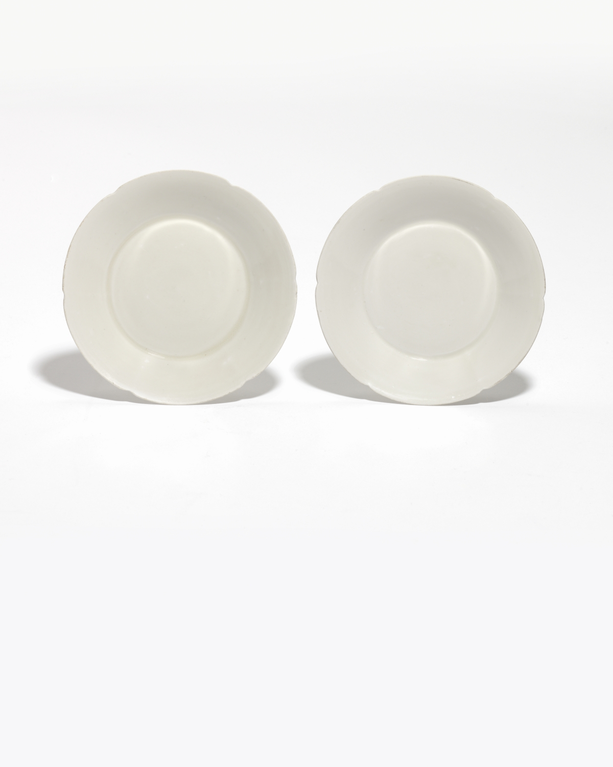 A pair of 'Ding' lobed dishes (Northern Song dynasty)