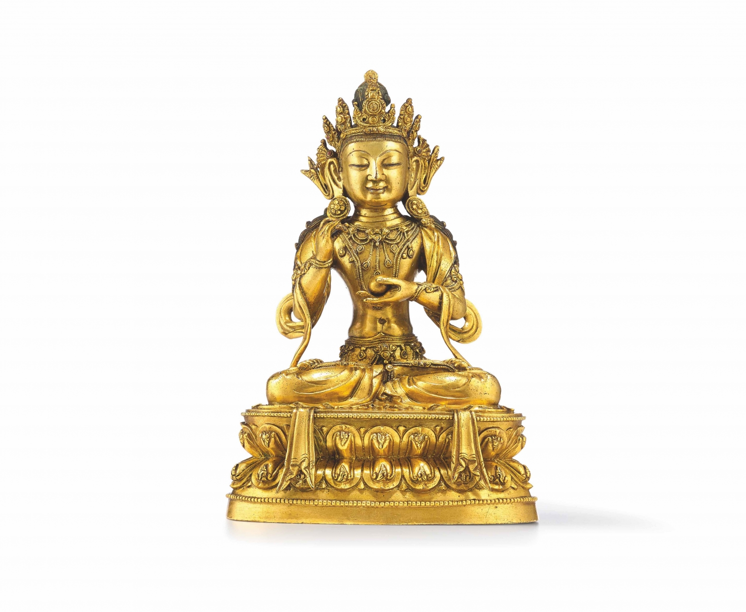 A gilt copper alloy seated figure of Avalokitesvara/Guanyin