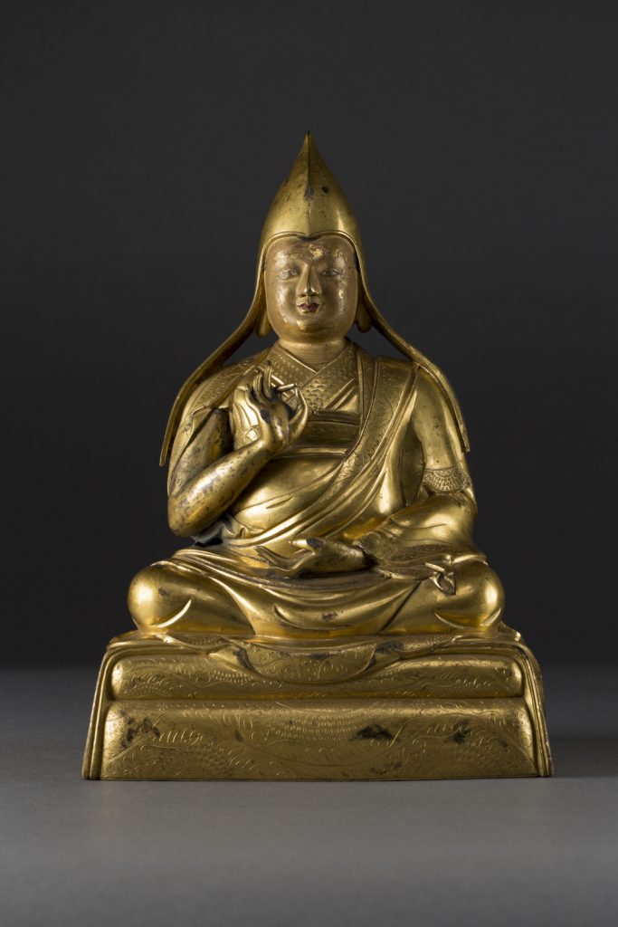 A gilt-bronze figure of Gelugpa Lama