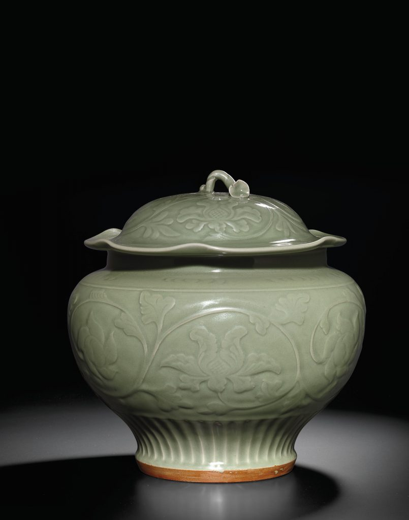 A carved Longquan celadon jar and cover (Yuan/early Ming Dynasty)