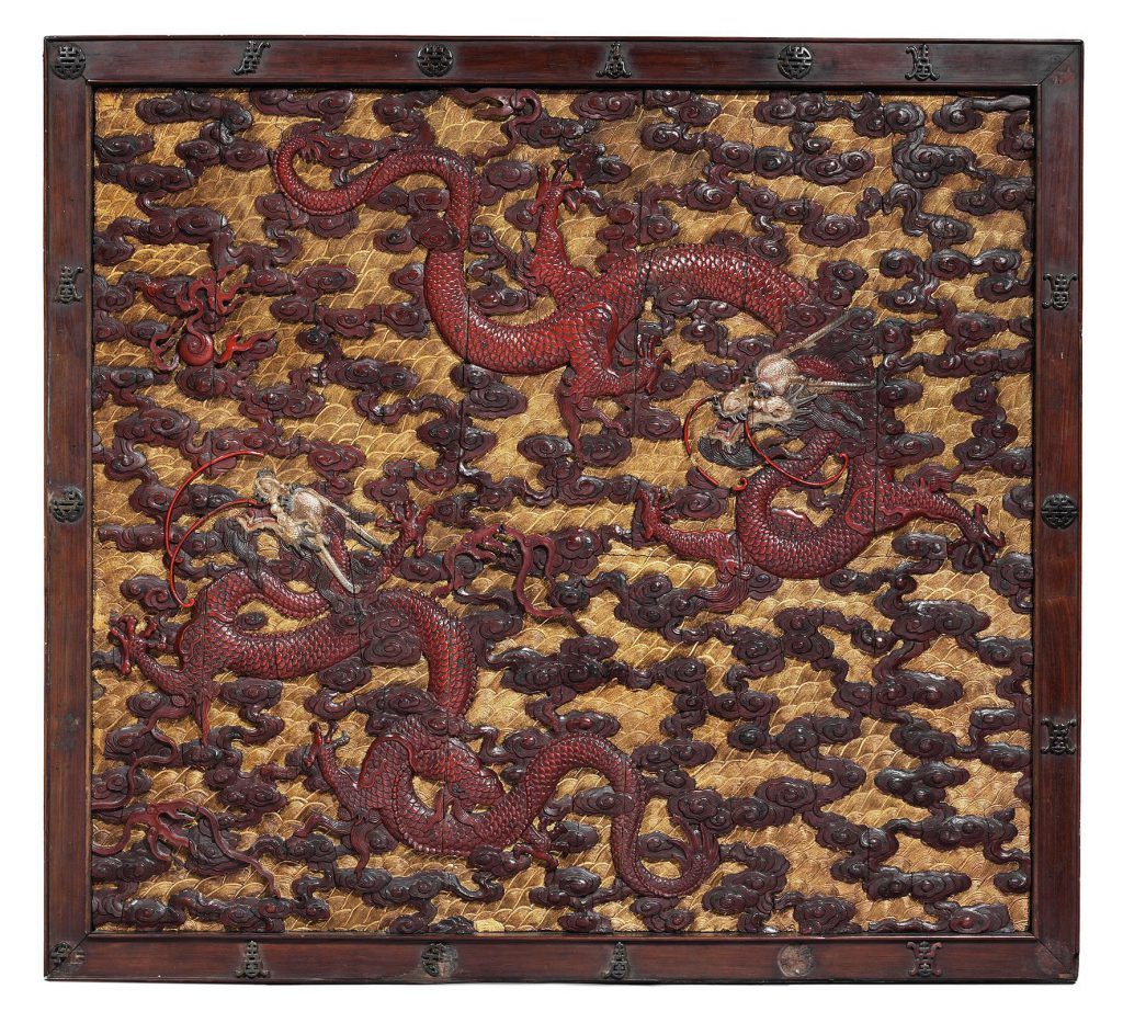 A pair of imperial carved wood, polychrome and gilt-lacquered 'dragon' panels (one of two)