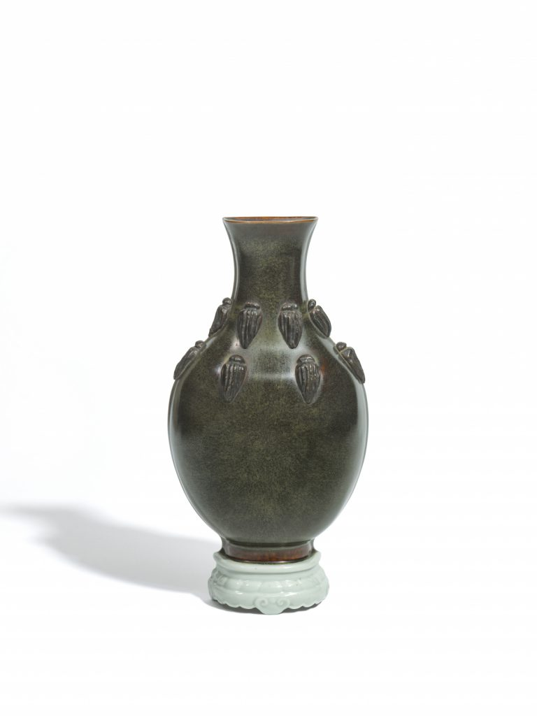 A black-glazed trompe l'eoil wall vase with applied cicadas on a faux-ivory celadon stand (Qing dynasty, 19th century)